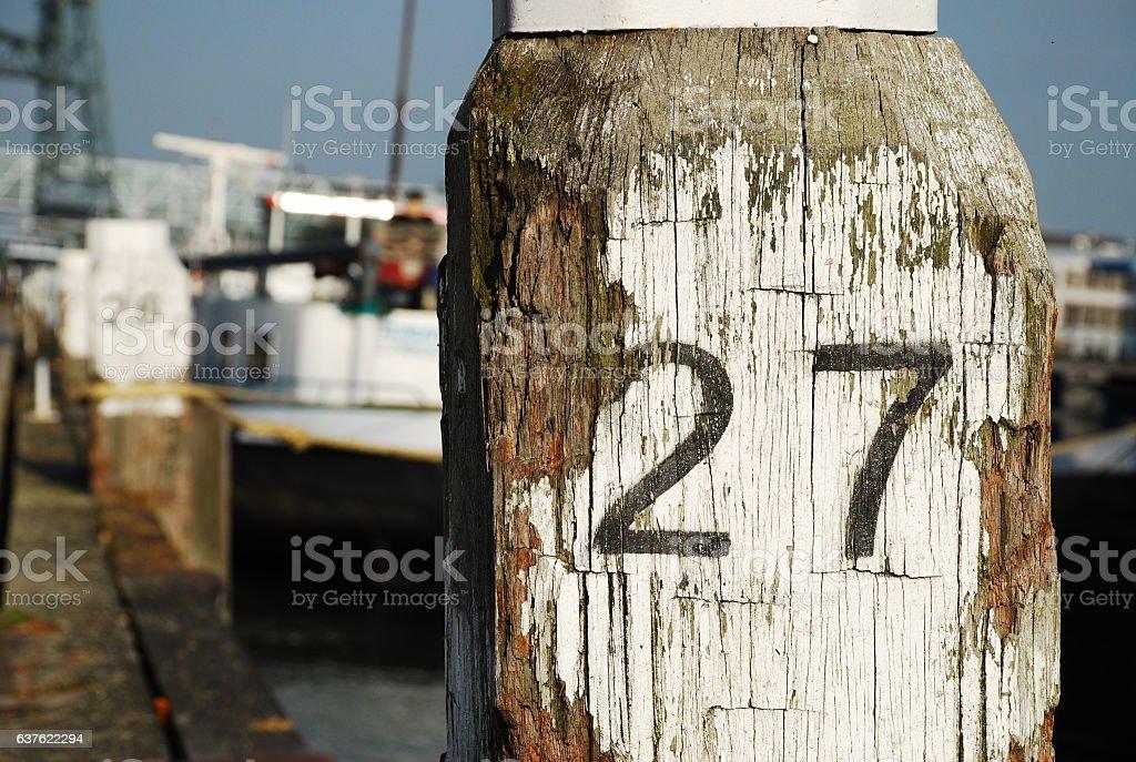 Weathered wooden pole stock photo