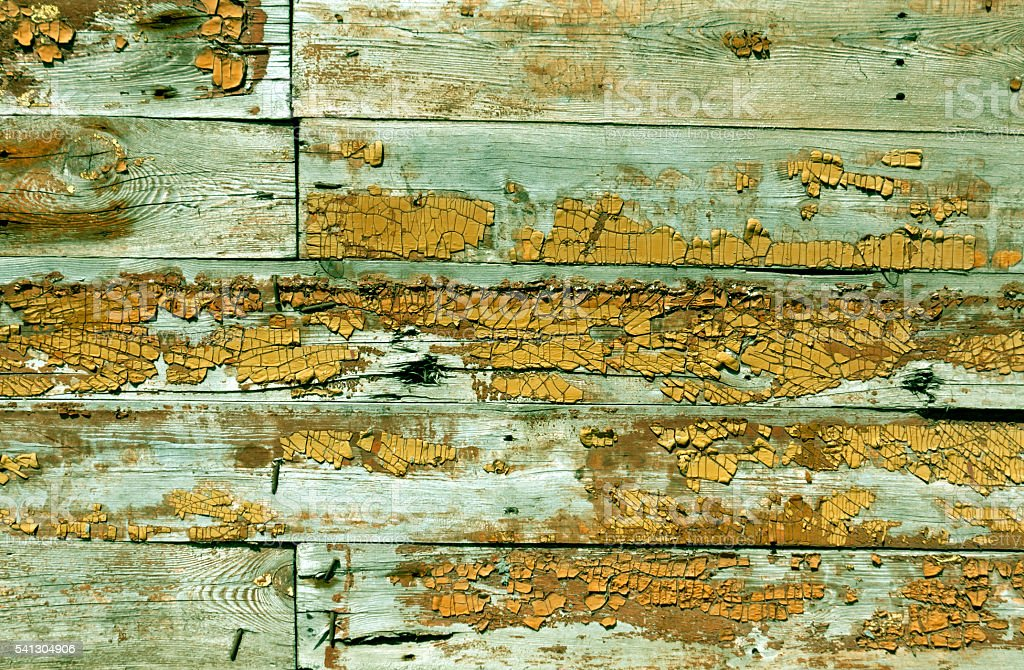 Weathered wooden wall texture with old paint. stock photo