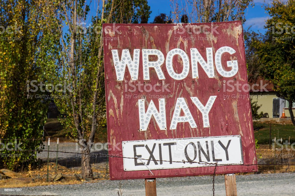 Weathered Wrong Way Sign stock photo