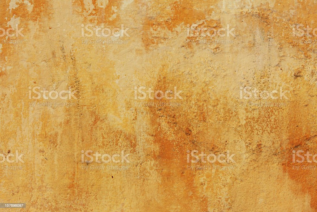 Weathered yellow wall background stock photo