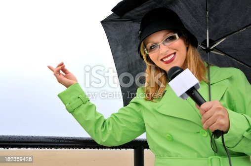 istock Weathergirl Smiles at Clearing Weather 182359428