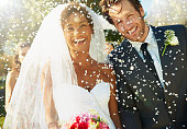 Shot of a happy newlywed couple being showered with confettihttp://195.154.178.81/DATA/i_collage/pu/shoots/784347.jpg