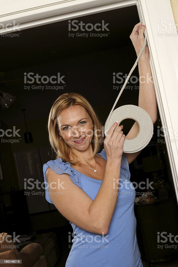 Weatherstripping Woman Smiles at Camera stock photo
