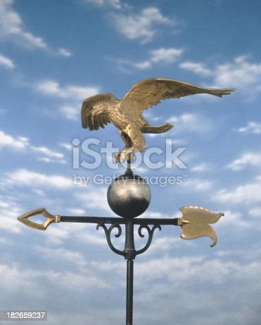 istock Weathervane and blue sky 182659237