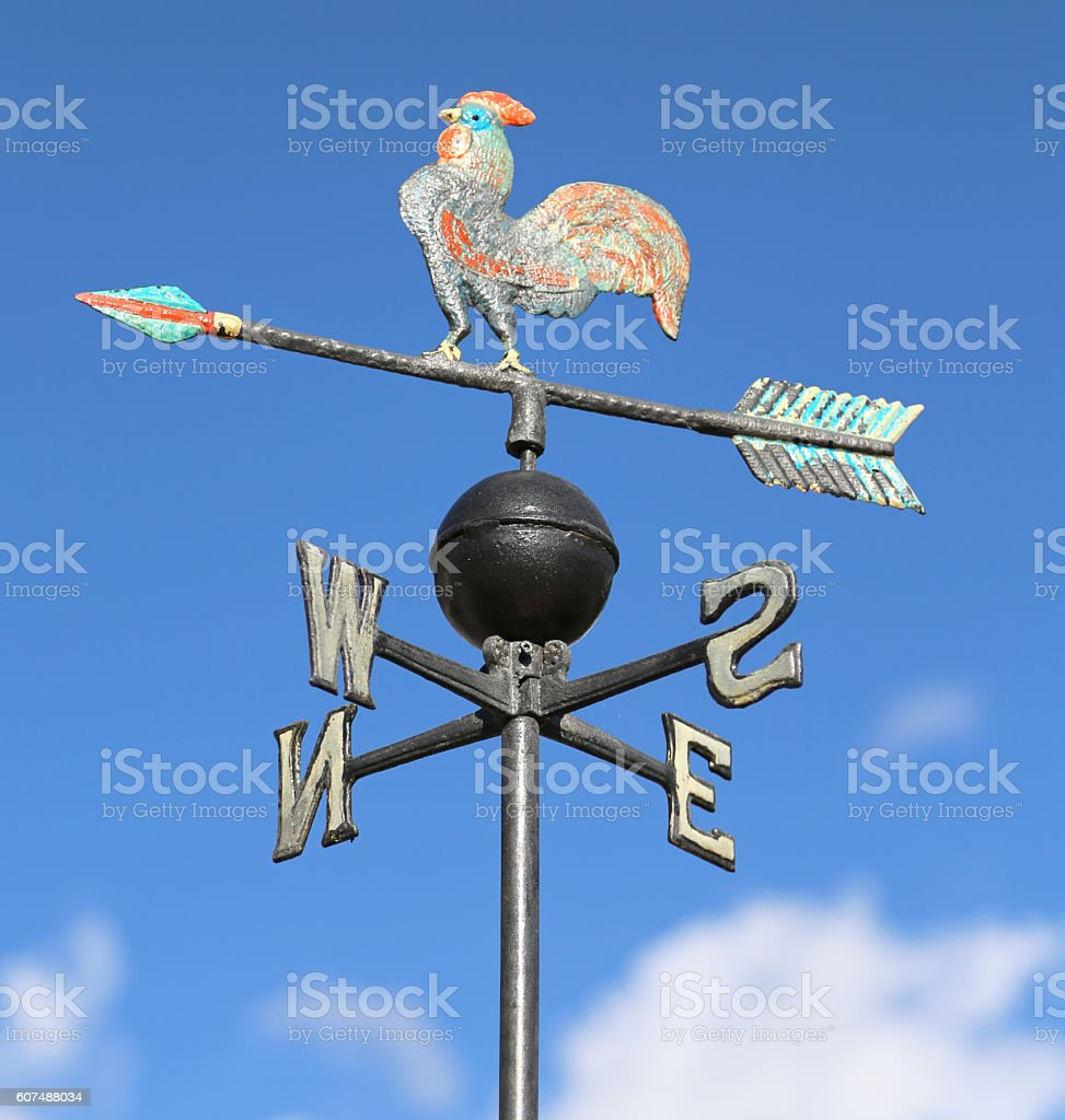weathervane with rooster above an arrow stock photo