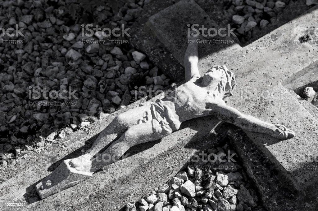 Weathred cross with Jesus Christ stock photo