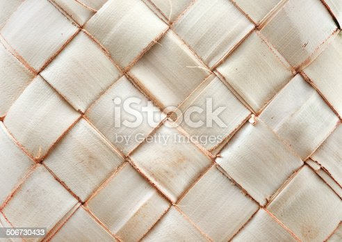 istock Weave pattern of palm leaves 506730433