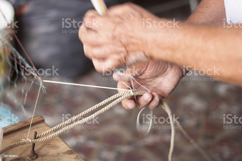 Weaving a fishnet stock photo