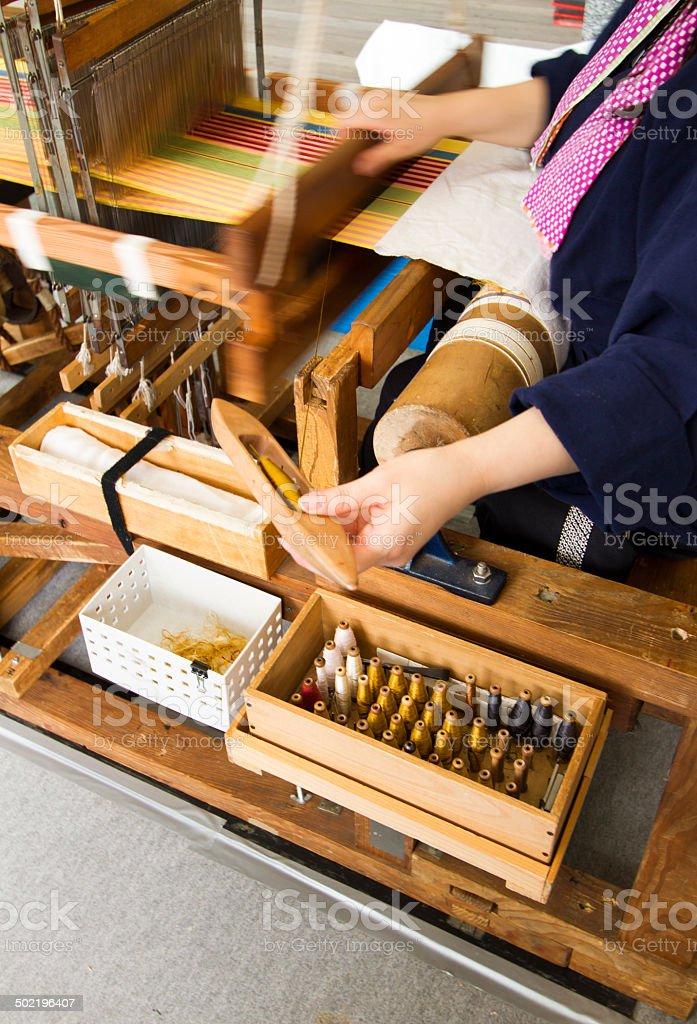 Weaving an Obi stock photo
