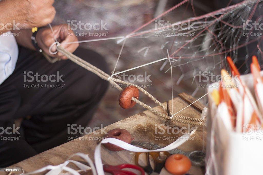 Weaving fishnet stock photo