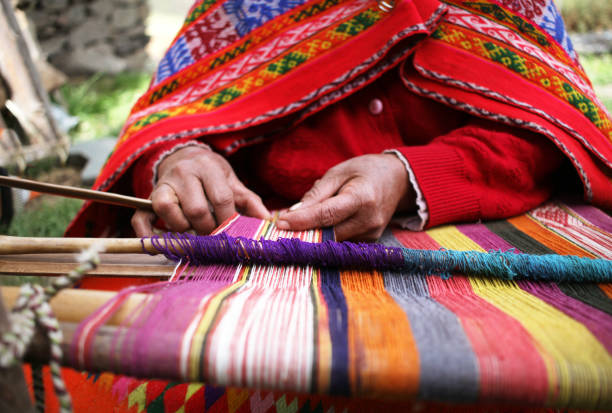 Weaving in Peru A close up of a woman weaving in Peru with bright traditional clothes. peruvian culture stock pictures, royalty-free photos & images