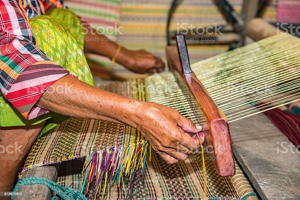 Weaving mats from dry reed stock photo