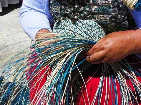 Weaving of Panama hat, Ecuador