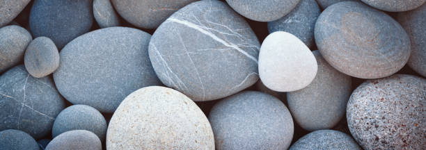 Web banner abstract smooth round pebbles sea texture background stock photo