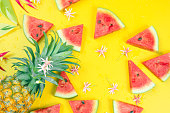 istock web banner and minimal flat lay creative design for group of summer fruits with fresh watermelon and pine apple on pastel yellow color background 1145867299
