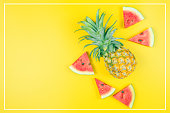 istock web banner and minimal flat lay creative design for group of summer fruits with fresh watermelon and pine apple on pastel color background 1156281435