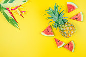 istock web banner and minimal flat lay creative design for group of summer fruits with fresh watermelon,pine apple and heliconia tropical flower on pastel color background 1157996623