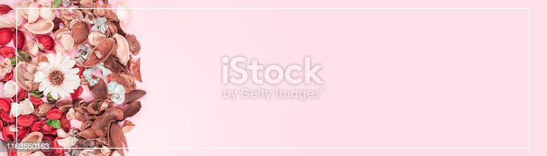 istock web banner aroma therapy and spa object in spring season by minimal flat lay style with group of dry tropical leaf decorate on pink vintage background 1163550163
