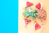 istock web banner freshness fruit and drink in summer season concept from minimal flat lay pineapple watermelon and tropical flower lay on pastel yellow blue background 1171157476