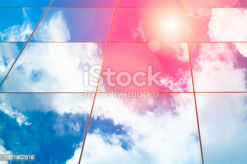 Web banner Modern glass architecture with reflection of red and blue sunset sky. Dramatic bright color. Vintage style background.