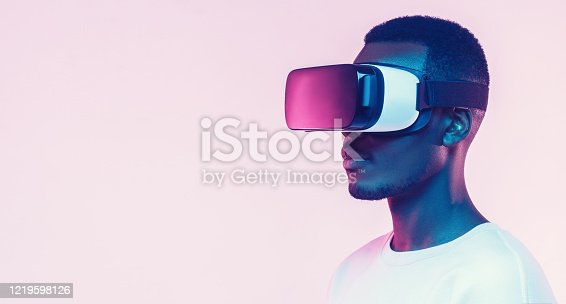 Web banner of young african man wearing virtual reality headset. VR concept.