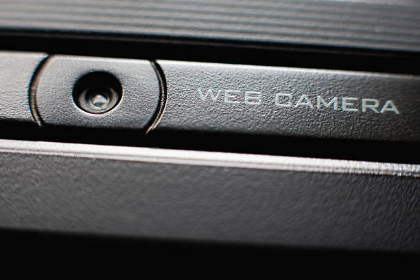 web camera close up on laptop - webcam stock photos and pictures