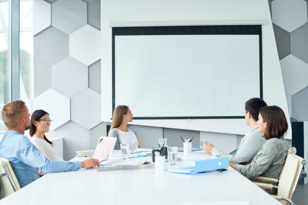 web conferencing with business partner - projection screen stock photos and pictures