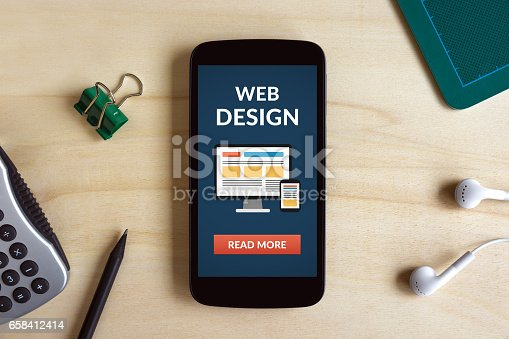 istock Web design concept on smart phone screen on wooden desk 658412414