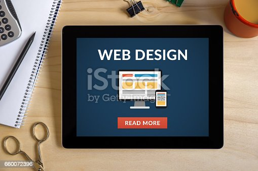 istock Web design concept on tablet screen with office objects 660072396