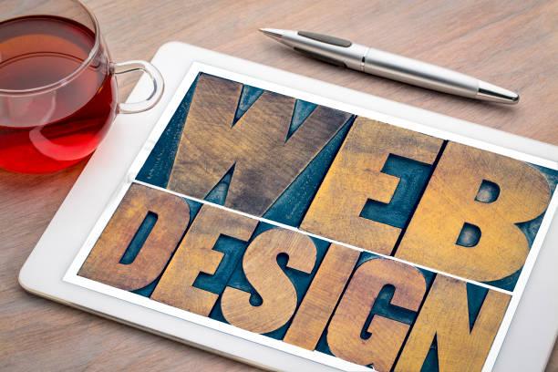 web design wort abstrakt auf einem digitalen tablet - www kaffee oder tee stock-fotos und bilder