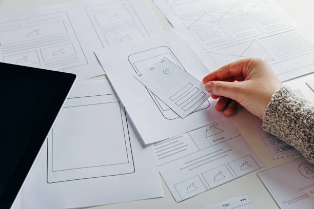 Web designer creating mobile responsive website stock photo
