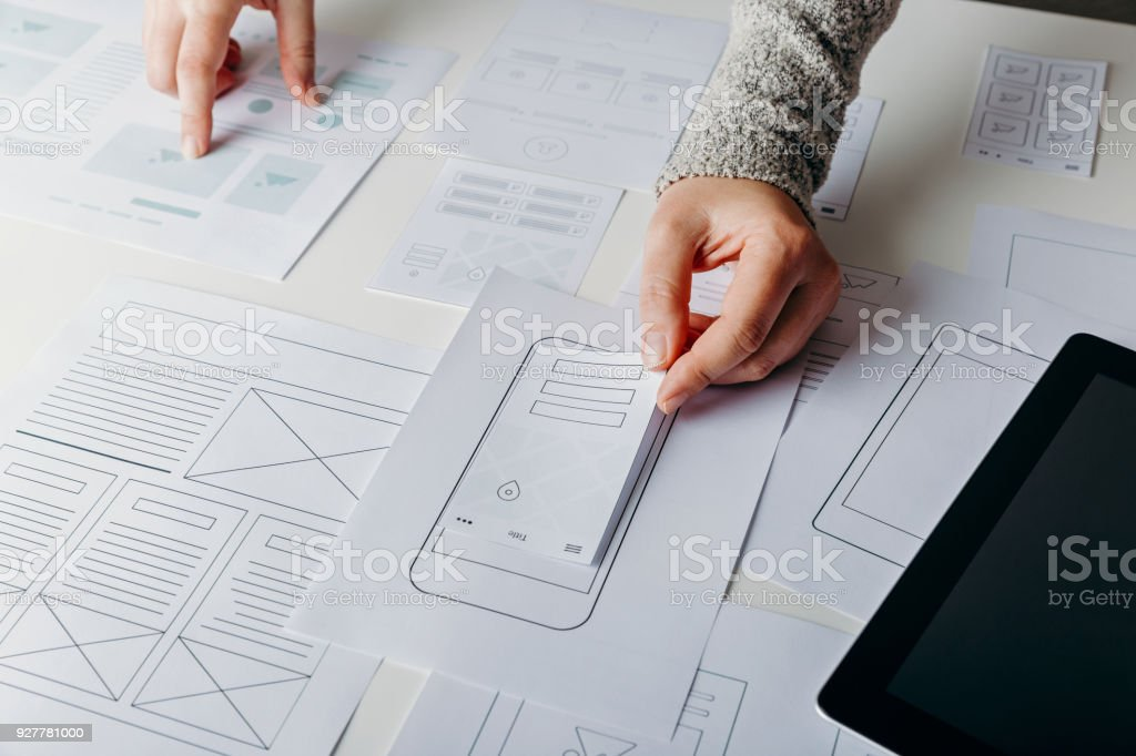 Web designer creating mobile responsive website stock photo