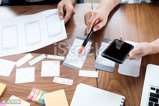 istock Web designer planning application for mobile phone 827676496
