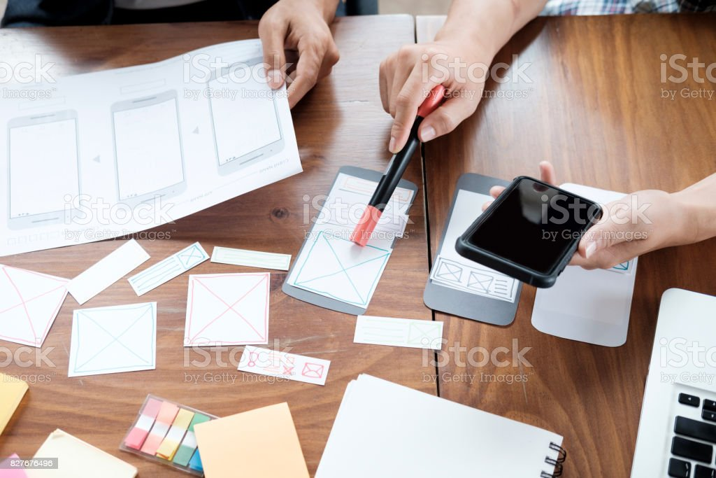 Web designer planning application for mobile phone stock photo
