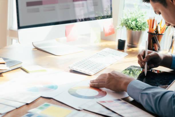 Web designer, UX UI designer designing mobile application user interface stock photo