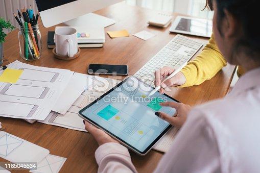 Web designer, UX UI designer designing mobile application user interface. Creative planning application development sketch layout wireframe design.