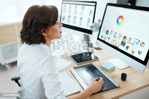 Web Designer Working On Computer. Woman Creating Web Design, Working On Project In Office. High Resolution