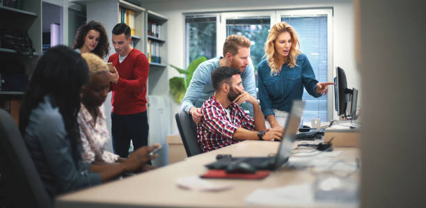 web designers at work. - web designer stock photos and pictures