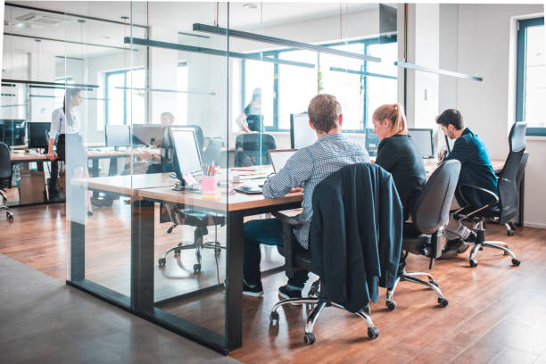Web designers working at desk in creative office stock photo