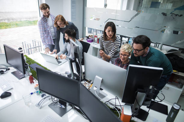Web designers working in office on project together Web designers working in office on project together. software developer stock pictures, royalty-free photos & images