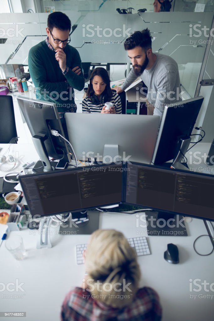 Web designers  working in office on project together stock photo