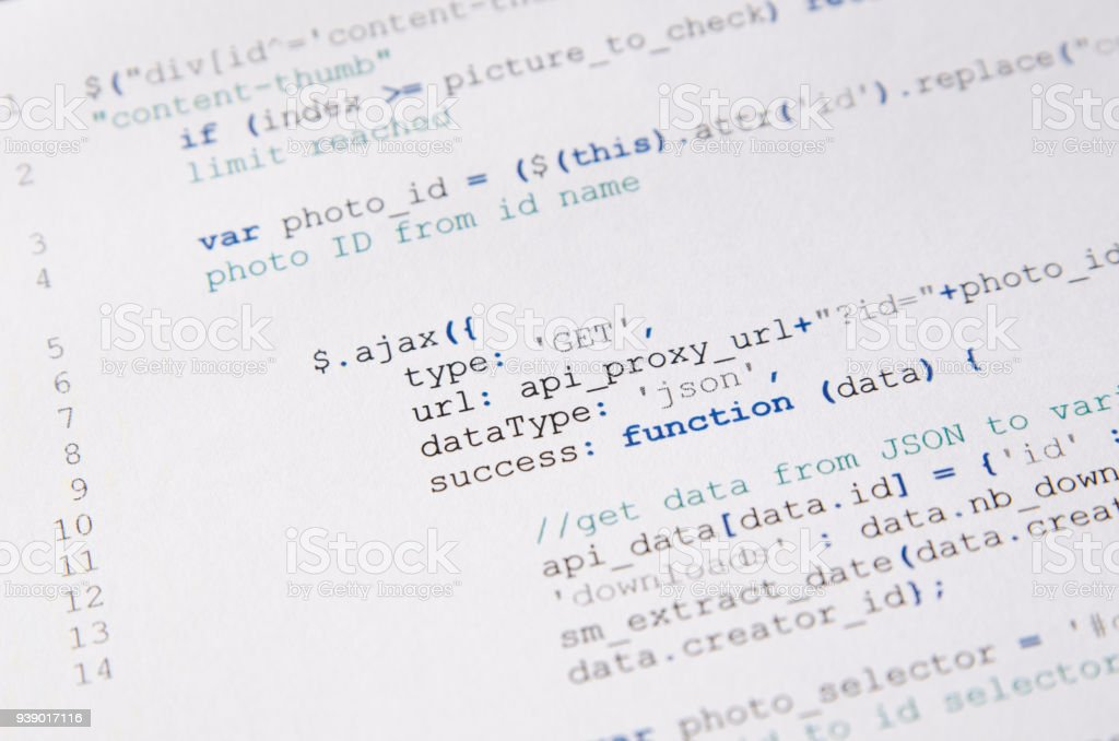 Web developer programming code printed on a piece of paper stock photo