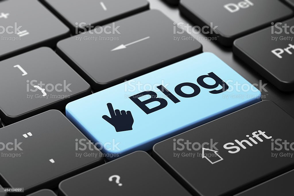 Web development concept: Mouse Cursor and Blog on keyboard stock photo