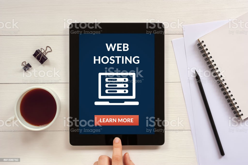 Web hosting concept on tablet screen with office objects stock photo