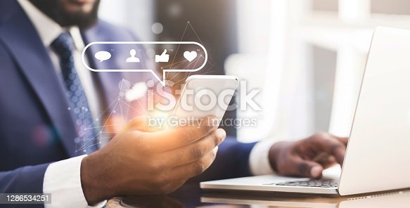 Web marketing specialist with mobile phone and laptop creating engaging social media content to promote brand, collage with free space. SMM manager researching target audience