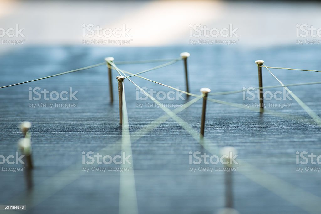 Web of wires, showing connections between groups and singles stock photo