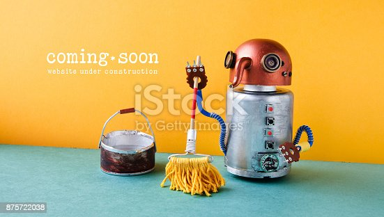 istock Web site under construction Coming Soon template page. Robot washer with mop and bucket of water, orange wall green floor interior 875722038