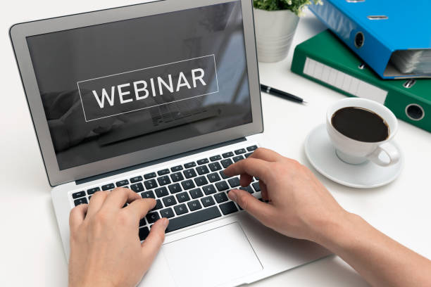 Webinar online, internet education, e-learning Webinar online, internet education, e-learning concept. Man typing on laptop keyboard. desaturated stock pictures, royalty-free photos & images