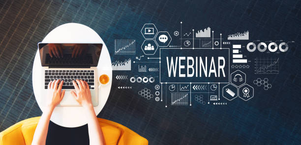 Webinar with person using a laptop stock photo