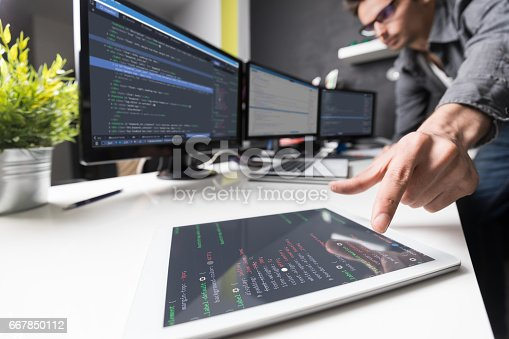 518433812istockphoto Website design. Developing programming and coding technologies. 667850112
